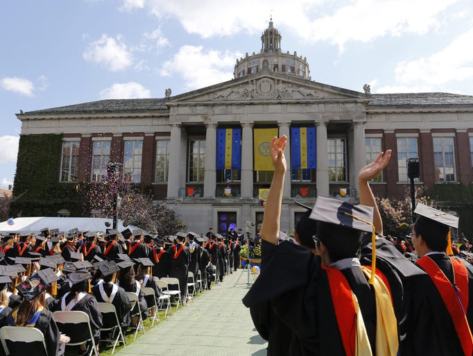 Graduates celebrate at the University of Rochester's 164th Commencement Ceremony on Sunday, May 18, 2014.
