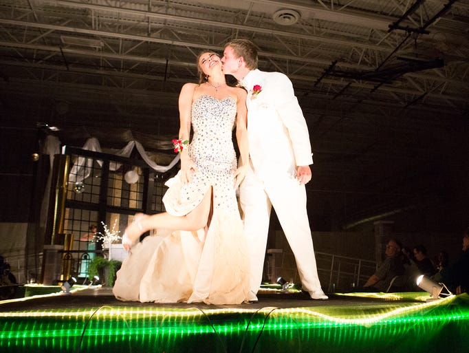 Alicia Houdek and Cody Kruize take part in prom grand march at Sauk Rapids-Rice High School in Sauk Rapids. .