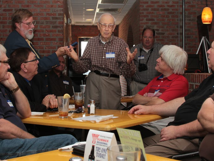 Vince Tapler tells a story about his time in the radio business during a meeting of the members of the Tennessee Radio Hall of Fame on Saturday at Charlie Bulldogs in downtown Jackson.
