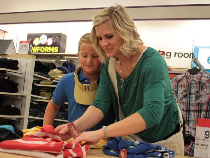Michelle French helps Cole Ballard, 9, shop for school clothes during the tax-free sales day at JCPenney inside the Old Hickory Mall in Jackson on Sunday afternoon.