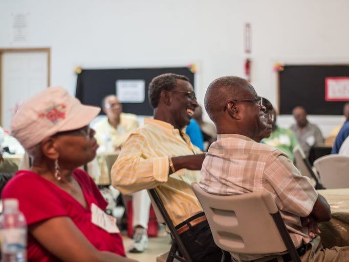 Attendees laugh and enjoy the fellowship during a reunion/meet and greet at St. John No. 2 Baptist Church in Denmark, TN