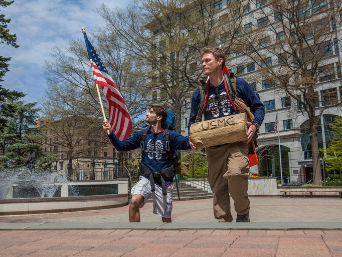 Ross Delafield (right)  and Joshua Perry, begin todays walk in Wilmington on West Street to eventually end up in Newark on their trip to DC.