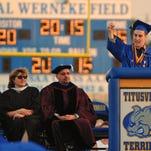 Titusville Terrier Kade Davis delivers a speech at Al Werneke Field next to the school campus on Friday.