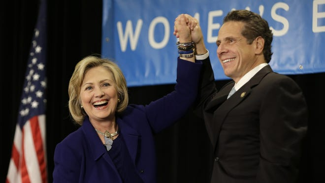 """Hillary Clinton and New York Gov. Andrew Cuomo acknowledge supporters during a """"Women for Cuomo"""" event on Oct. 23, 2014 in New York. She is set to endorse him for a third term on Wednesday."""