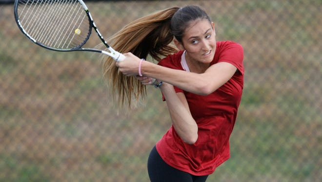 Arlington's Maranda Sears returns a volley during the girls sectional tennis finals at Harrison High School on  Thursday, Oct. 22, 2015.