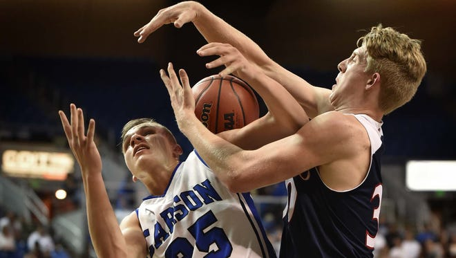 Carson's Jayden DeJoseph loses the ball as he is pressured by Coronado's Kennedy Koehler in first half of the 2016 NIAA Division State Basketball Championships at Lawlor Events Center on Thursday.