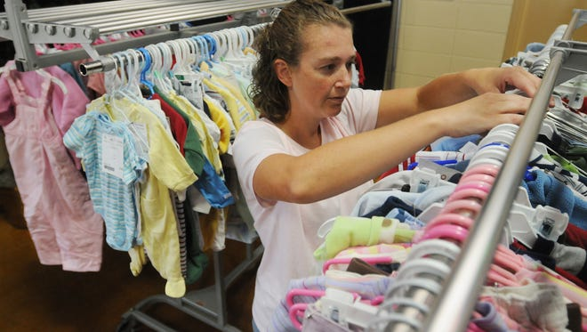 FILE IMAGE: A volunteer with the Coastal Kids Consignment Sale checks the inventory. The annual sale at the Wicomico Youth & Civic Center starts March 17 and runs through March 19.