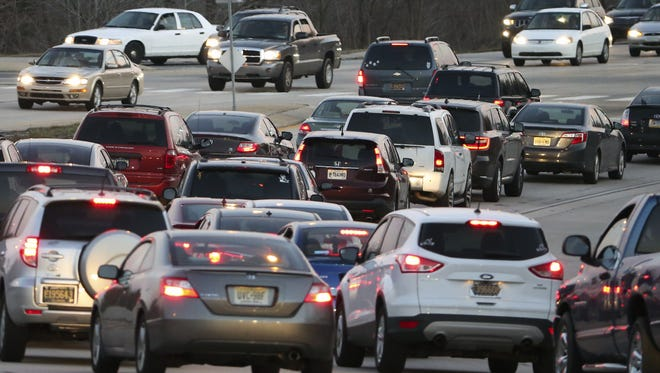 Traffic at Del. 273 and Red Mill Road near Newark is shown. Lawmakers want to double fines for texting or making a hand-held phone call while driving.