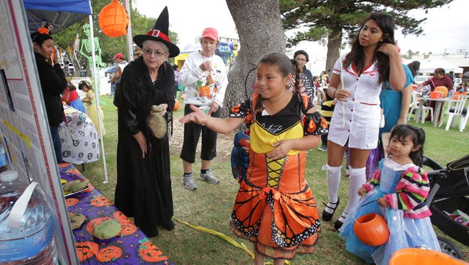 Heritage Square docent Loretta Collet, left, watches Mikaela Lopez, center, at the 2014 Halloween Haunt in the Park. This year's event will take place from 4-7 p.m. Oct. 28 at Plaza Park in Oxnard.