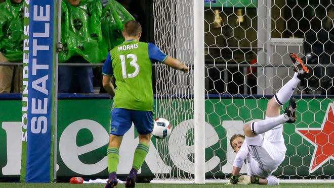 Seattle Sounders forward Jordan Morris (13) sets up to score a goal on Colorado Rapids goalkeeper Zac MacMath during the first half of the first leg of the MLS soccer Western Conference championship, Tuesday, Nov. 22, 2016, in Seattle. (AP Photo/Ted S. Warren)