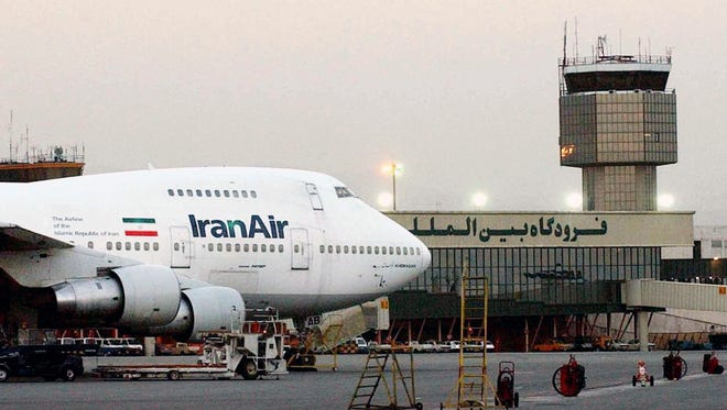 In this June 2003 file photo, a Boeing 747 of Iran's national airline is seen at Mehrabad International Airport in Tehran. Iran said Sunday it has finalized a $16.8 billion deal with Boeing to purchase 80 passenger planes, a deal made possible by last year's landmark nuclear agreement.