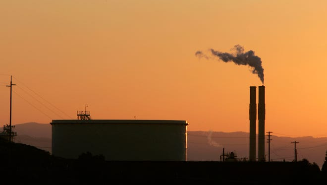 In this Friday Sept. 22, 2006, file photo, an oil refinery is seen at sunset in Rodeo, Calif.  California was one of the three states to form the U.S. Climate Alliance.