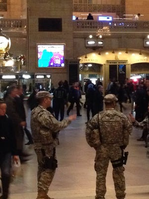 U.S. National Guard officers patrol Grand Central Nov. 4, the day after about two-dozen people staged a protest in the main concourse following a grand jury's decision in the fatal chokehold case. No protests have occurred in the terminal Thursday morning.