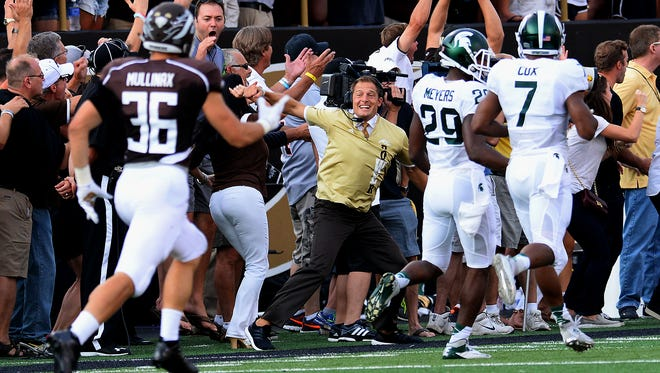 Western Michigan head coach P.J. Fleck wears a big smile as he cheers on his return team during Darius Phillips' 100-yard kick return for a touchdown in the first quarter of the Broncos' lost to Michigan State on Sept. 4.