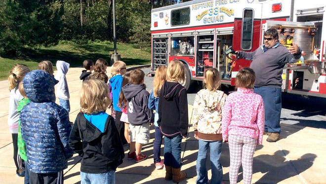 Students from Angela Rodriguez's second-grade class at Fort Zeller Elementary School in Richland listen to a presentation recently by Neptune Fire Co. Chief Matt Marks. Marks' visit was part of the school's fire prevention event. Students heard an assembly about fire safety and then had an opportunity to go out by classes to see and hear about the fire trucks and other rescue vehicles. Neptune Fire Co. is in Richland.