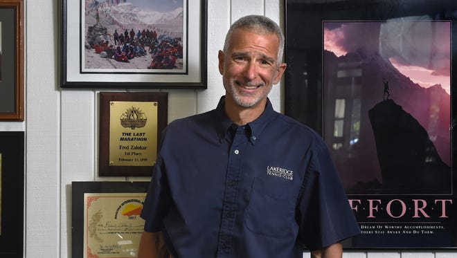Fred Zalokar, shown in his office at Lakeridge Athletic Club, is the first person to win his age group in all six World Marathon Majors.