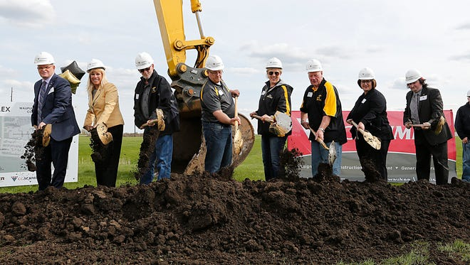 Local government and school representatives take part in the ground breaking of Waupun School District's sports complex Wednesday. Pictured from left are: State Senator Dan Feyen and Waupun School Board members Tonya Gubin, Glen Wilson, Bill Bruins, Jennie Patrykus, Ron Paul, Kathy Schlieve and Dylan Weber.