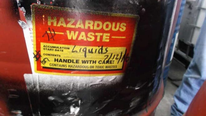 State environmental regulators issued violations at three Container Life Cycle Management industrial barrel reconditioning plants in Milwaukee County for having hazardous waste on site without a permit. The label on this barrel indicates a permit is needed, the state Department of Natural Resources says.