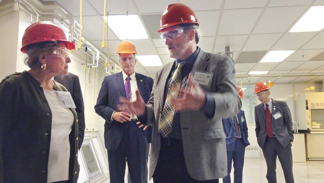 AIM Photonics CEO Michael Liehr, front right, leads a tour of the future Testing, Assembly and Packaging facility Thursday, Sept. 21, 2017 in Rochester, explaining details to US Representative Louise Slaughter, D-Fairport.