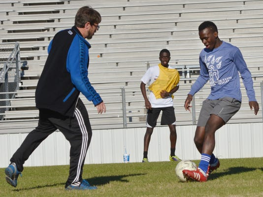 ANI Bolton Soccer Bolton sophomore forward Nicolas Mboungou (left) runs drills with coach Jeremy Poklemba Thursday, Feb. 19, 2015.-Melinda Martinez/mmartinez@thetowntalk.com The Town Talk Gannett