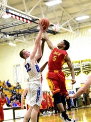 Lorenzo Sparks (5) of North College Hill swipes a rebound