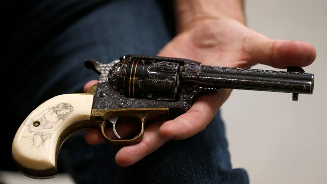 """One of Jim Downing's favorite firearms that he has engraved for himself, that he calls his barbecue gun, a Ruger Vaquero. """"It's a $300 gun with $4,000 worth of stuff in it!,"""" said Downing."""