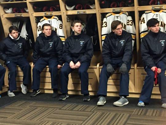 Livonia Stevenson hockey players listen to Adrian coach