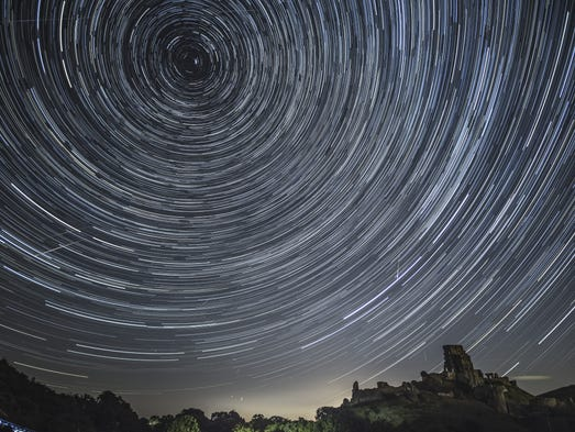 Satellites, planes and comets transit across the night