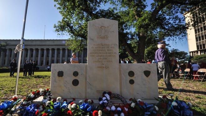 Flowers and wreaths are laid on the Tom Green County Veteran's Memorial after a Memorial Day Ceremony at courthouse in San Angelo.