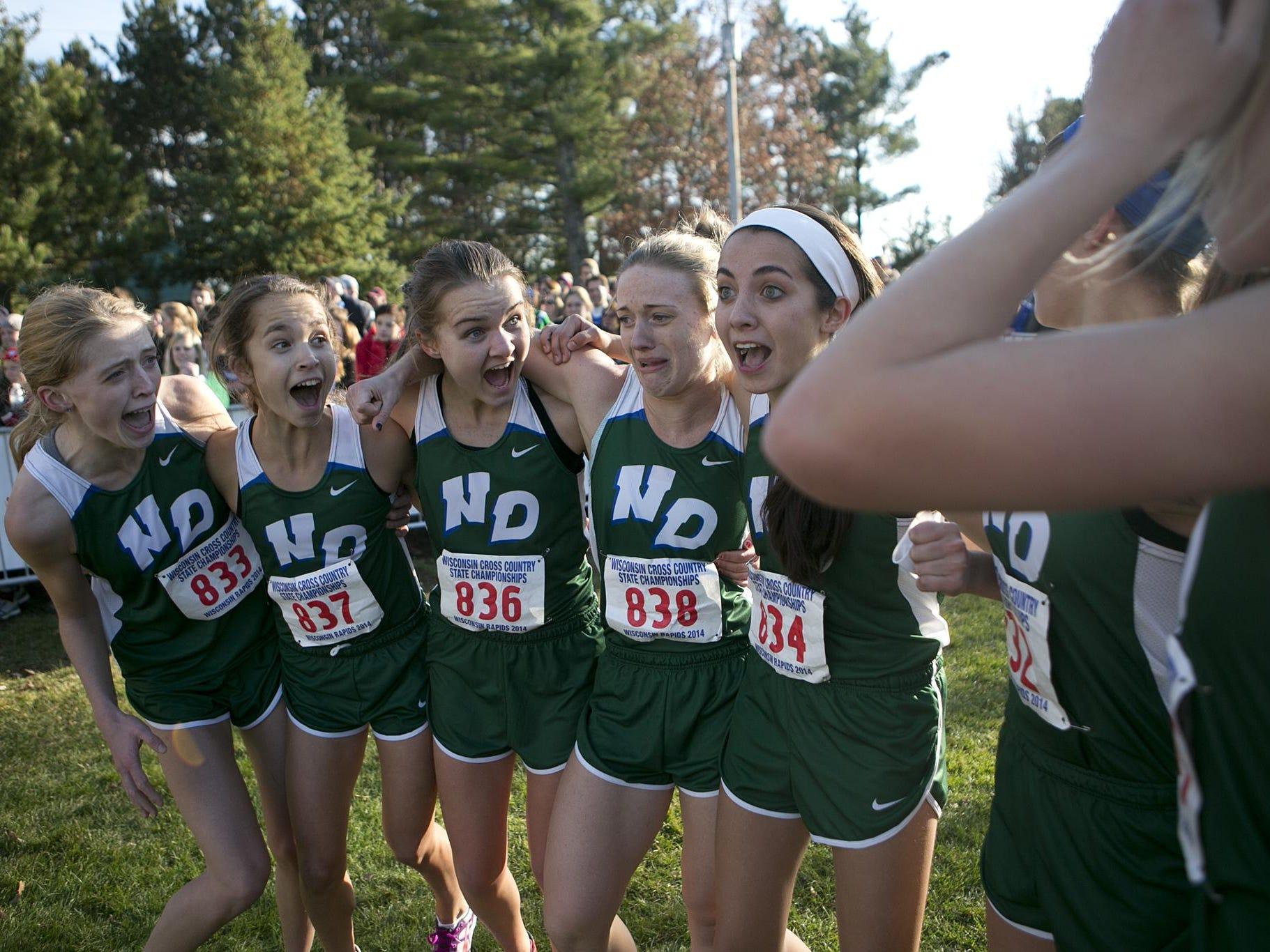 From left, Notre Dame's Kelley Gardipee, Ashley Laskowski, Anna Patterson, Kristen Burkel, Jessica Reigh, Maria Ehlinger and Veronica Letter celebrate the Tritons' championship.