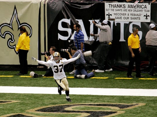 FILE - In this Sept. 25, 2006, file photo, New Orleans Saints' Steve Gleason (37) sprints through the end zone after blocking an Atlanta Falcons punt in the first quarter of their NFL football game at the newly reopened Louisiana Superdome, after Hurricane Katrina, in New Orleans. Like countless other New Orleans residents, the franchise spent much of the previous year coping with the devastation of Hurricane Katrina. Memories won't feed a family or rebuild their house, which is why the first thing J.J. Watt brought back to his adopted hometown in the wake of Hurricane Harvey was $28 million in cold, hard cash. So when the Texans open the NFL season Sunday against Jacksonville at NRG Stadium, Watt and his teammates want to deliver a different kind of gift _ one of those iconic sports moments that will live long after the flood waters recede. (AP Photo/Bill Haber, File)