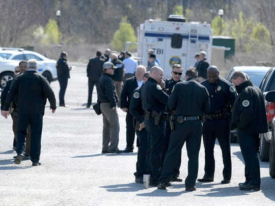 Police work the scene of an officer-involved shooting