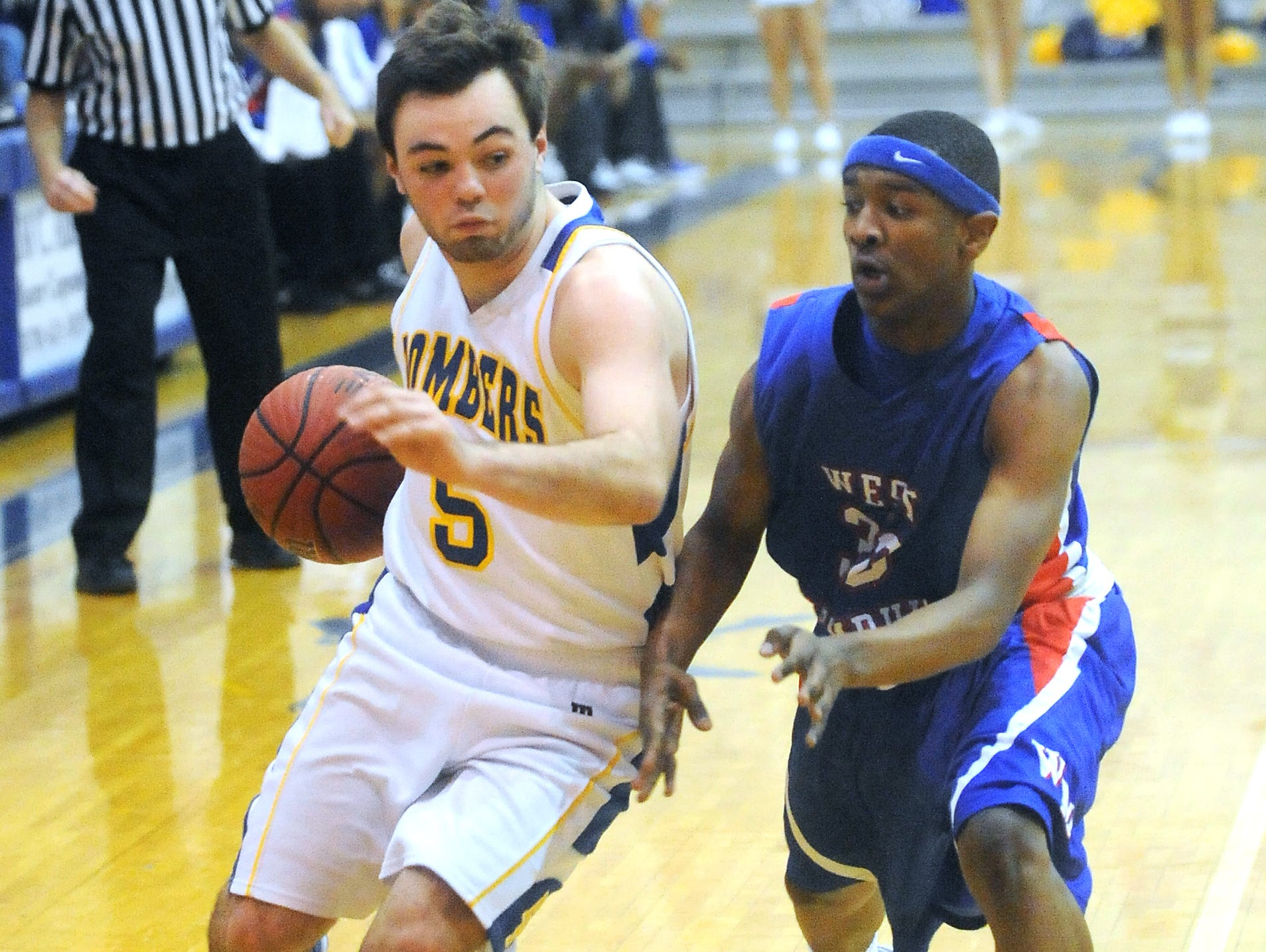 Mountain Home's Preston Groesbeck drives past a West Memphis defender during a game this past season at The Hangar. Groesbeck signed a National Letter of Intent on Wednesday to play at North Arkansas College in Harrison.