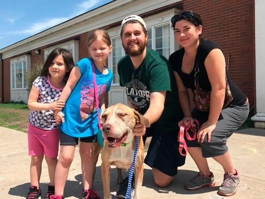 636618088559197113-AP-Lost-Dog-Reunited-NY107.jpg