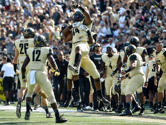 Vanderbilt defensive lineman Jalen Pinkney (44) reacts