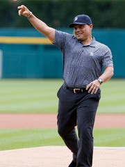 Former Detroit Tiger and Texas Ranger Ivan Rodriguez throws out a ceremonial first pitch before their baseball game at Comerica Park Saturday, May 7, 2016, in Detroit.