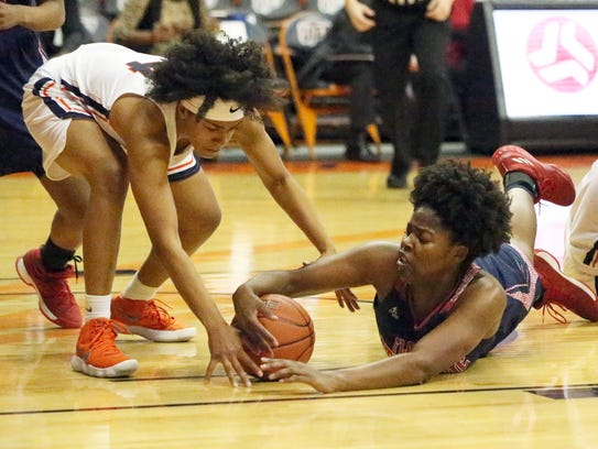 UTEP's Najala Howell, left, tries to grab the ball