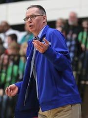 St. Peter head coach Joe Jakubick calls out a play