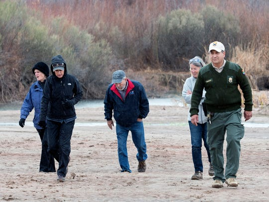 New Mexico State Parks Ranger Alex Mares and a group of hikers brave the elements to be part of America's State Parks First Day Hikes as they return across the bed of the Rio Grande at Leasburg Dam State Park.