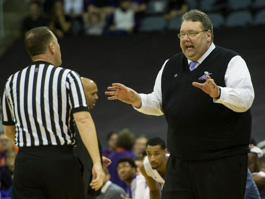 University of Evansville's  Head Coach Marty Simmons argues a call with the referee at the Ford Center on Saturday, Jan. 27, 2018. The Purple Aces defeated the Bulldogs 77-73.