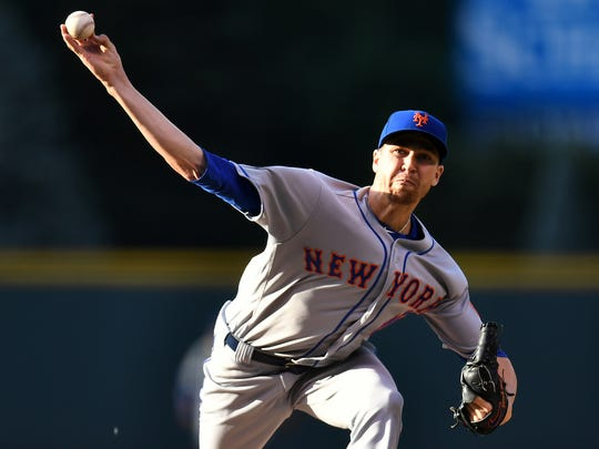 Jun 18, 2018; Denver, CO, USA; New York Mets starting pitcher Jacob deGrom (48) delivers a pitch in the first inning against the Colorado Rockies at Coors Field.