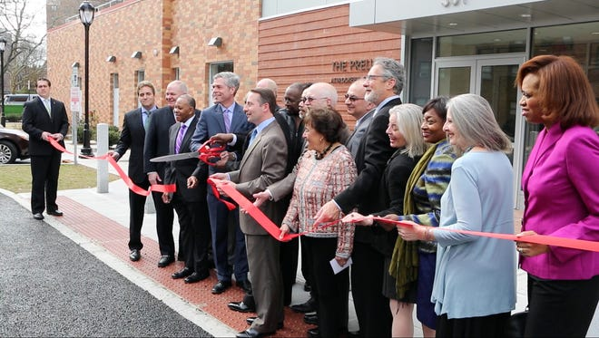 City, County, State and Federal officials cut the ribbon at the new White Plains Education and Training Center at The Prelude at Brookfield Commons, March 10, 2016. The 103-unit public housing and training center had over 100 people in attendance.