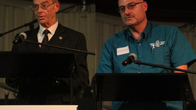 Brian Noe, left, and Charles Watson, right, speak during a candidate forum held at Christ's Family Church.