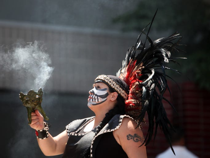 The Hispanic dance group Yayauhki Tezcatlipoca hold a ceremonial prayer with music during Guelaguetza, a cultural celebration of the traditions, arts, crafts and foods of Oaxaca, Mexico Aug. 10, 2014 at the New Rochelle Library Green.