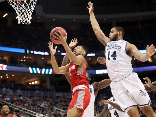 Radford Highlanders guard Carlik Jones (1) attempts a shot against Villanova Wildcats forward Omari Spellman (14) during the first half.
