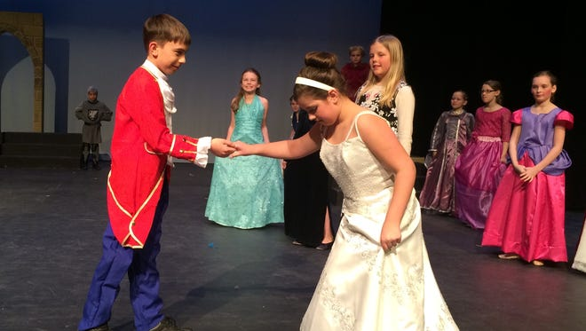 "Owen Bessey as Prince Theodore, left, and Amelia Marti as Cinderella rehearse Monday for Wisconsin Rapids Public Schools Children's Theatre's production of ""Cinderella."""