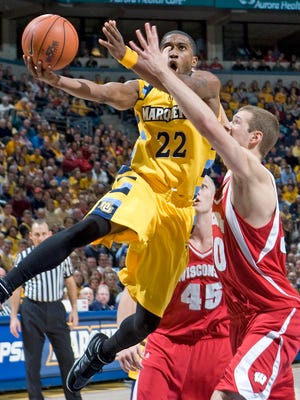 Jerel McNeal drives past Jon Leuer during a 2008 game between Marquette and Wisconsin at the Bradley Center. The Golden Eagles, then ranked No. 25, went on to beat the unranked Badgers, 61-58.