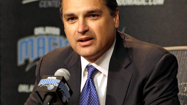FILE - In this March 15, 2012, file photo, Orlando Magic President Alex Martins answers questions during a news conference in Orlando, Fla. Martins is pleased with Orlando's young core of players and coach Frank Vogel, but is disappointed the team probably won't get to the playoffs for the first time in the post-Dwight Howard era. Martins says the future of the management team, including 34-year-old general manager Rob Hennigan, will be evaluated after the season. (AP Photo/John Raoux, File)