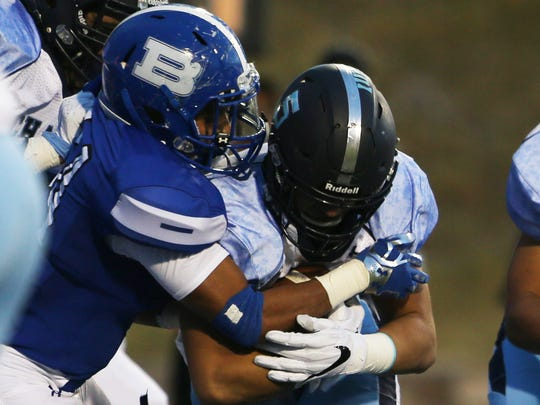 Chapin's Angel Soto crashes into Bowie's Juan Rojas, but manages to bull his way into the end zone Thursday.