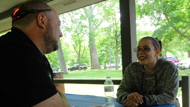 Ashley Driggs talks with Ross County Probation Officer Brandon Puckett during a celebration of the Ross County Common Pleas Drug Court in Yoctangee Park on Tuesday, May 23, 2017. Puckett is the director of the drug court for Judge Mike Ater.